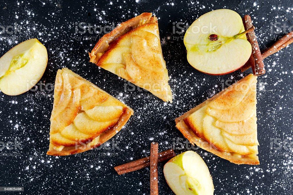 Slice of Golden Bramley apple tart with cinnamon glaze stock photo