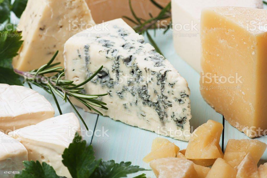 Slice of gorgonzola cheese stock photo