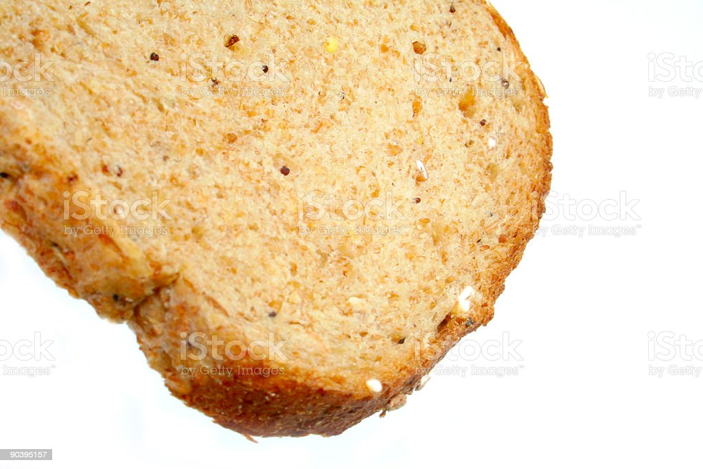 Slice of Granary Bread on a white background royalty-free stock photo