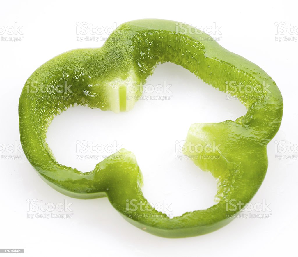 Slice of green bell pepper isolated on white royalty-free stock photo