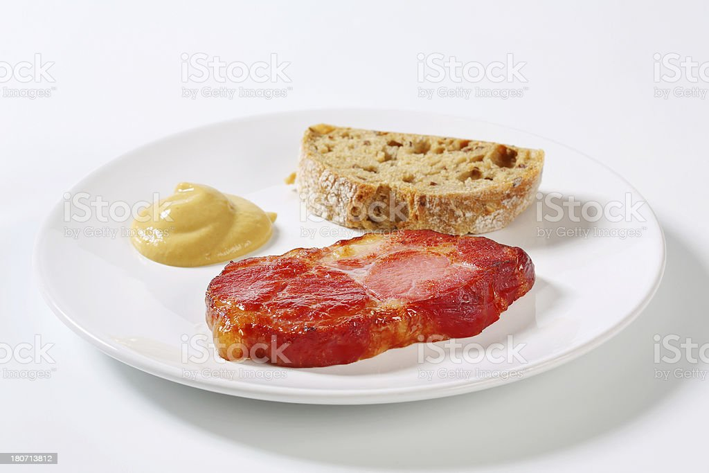 Slice of grilled pork neck with bread and mustard royalty-free stock photo