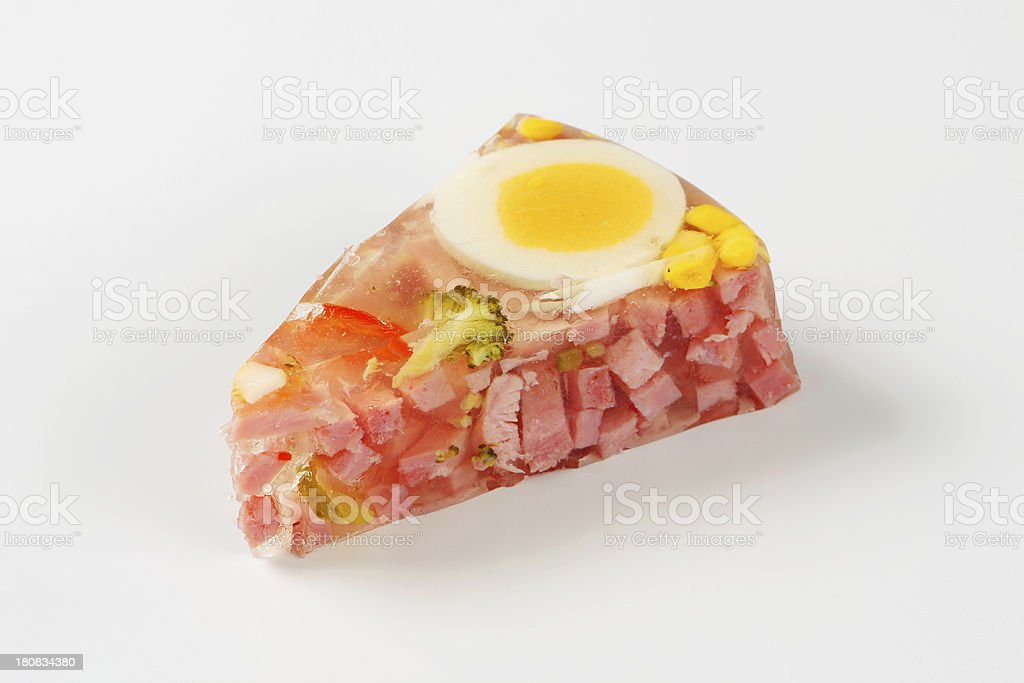 Slice of ham and egg aspic cake royalty-free stock photo