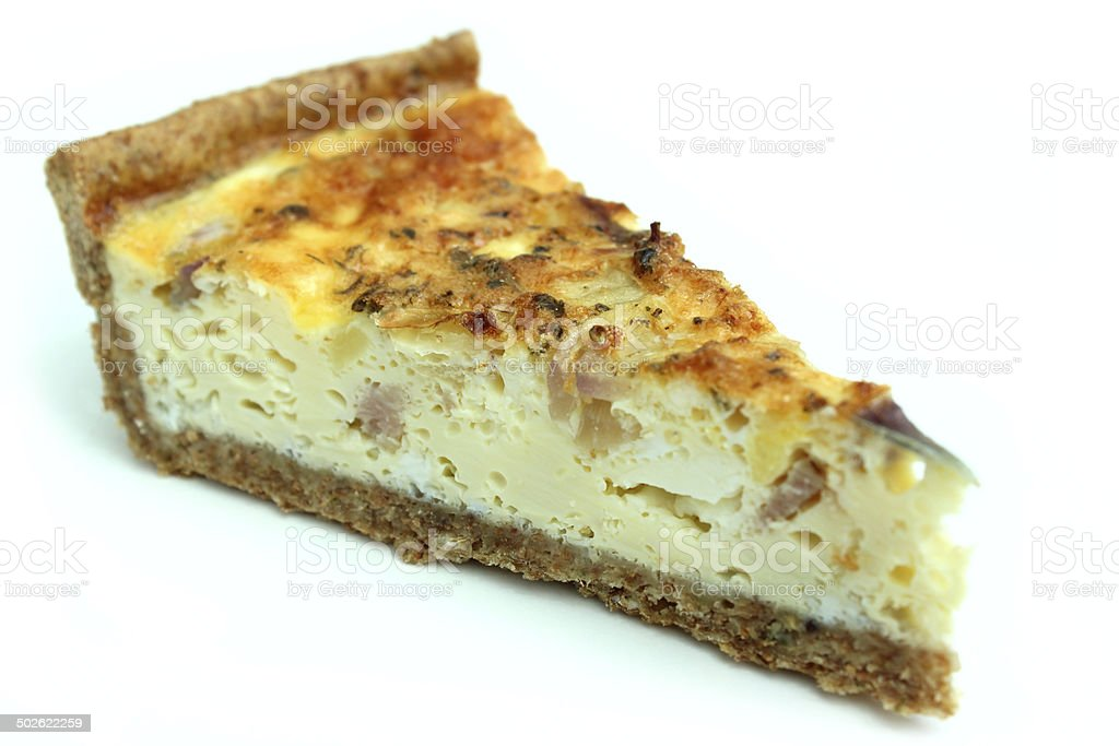 Slice of homemade bacon and egg quiche tart / savoury flan stock photo