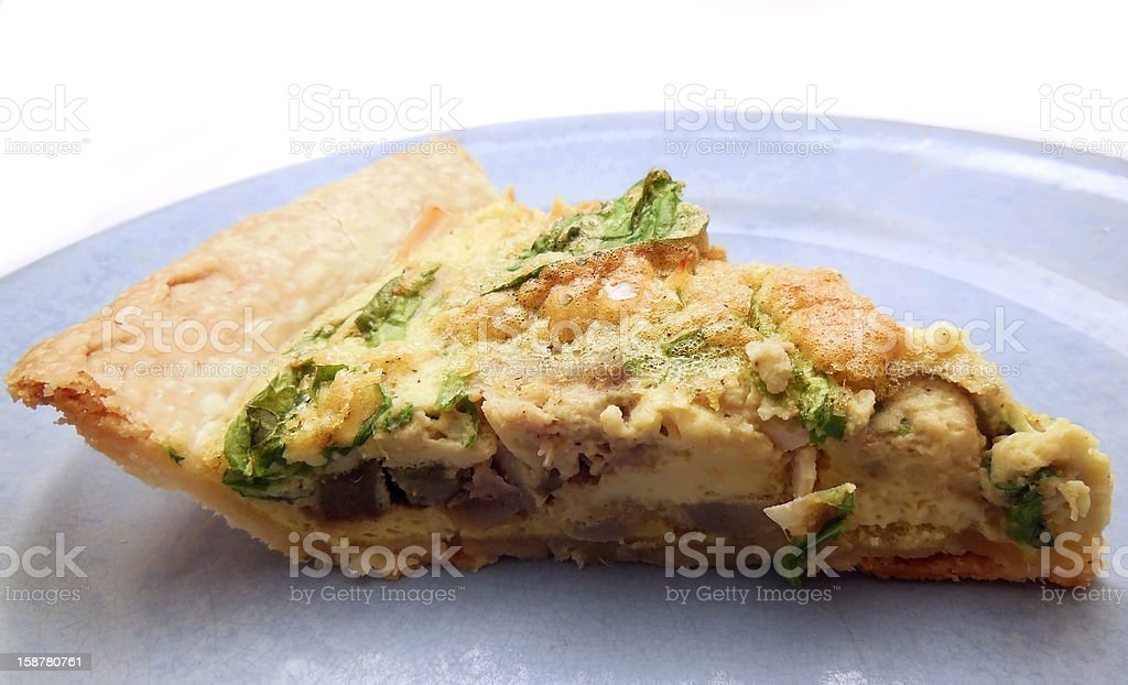 Slice of homemade quiche royalty-free stock photo