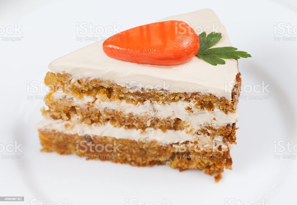 Slice of homemade tasty carrot sponge cake with pastry cream stock photo