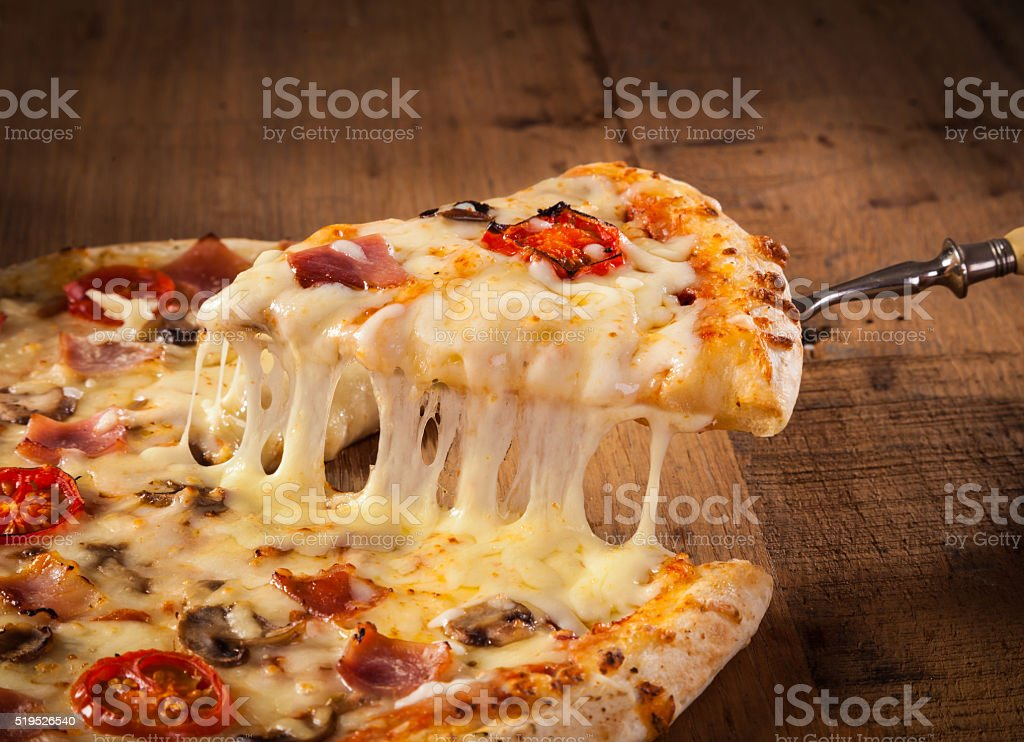Slice of hot pizza stock photo