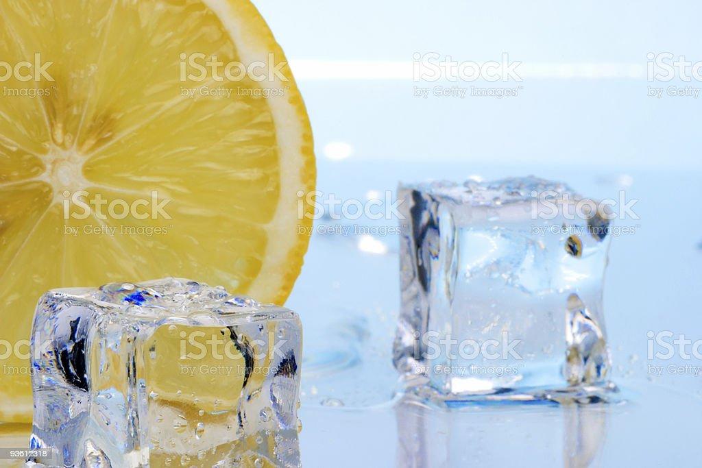 Slice of lemon and ice cubes royalty-free stock photo