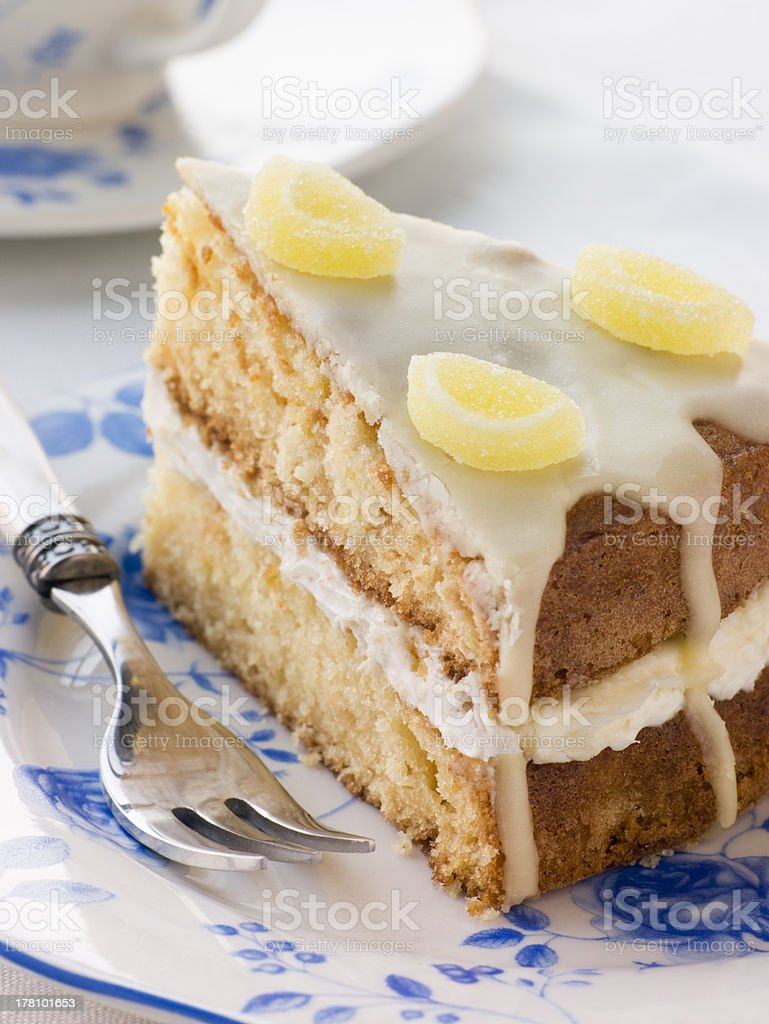 Slice of Lemon Drizzle Cake royalty-free stock photo