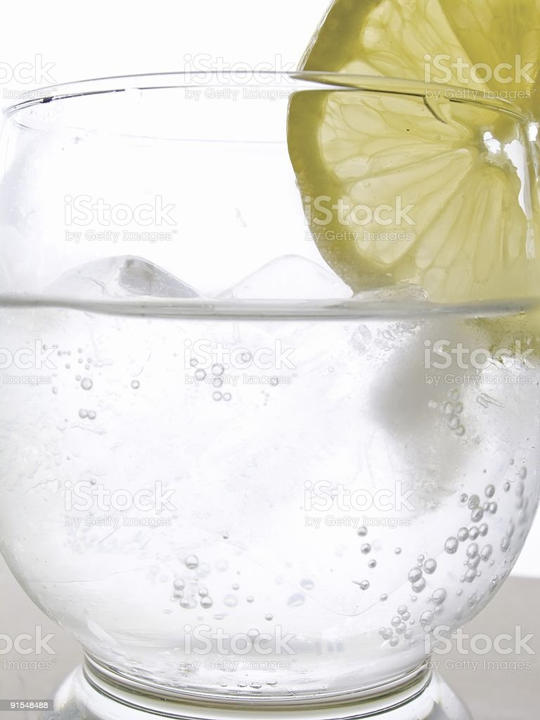 Slice of lemon in a drink royalty-free stock photo