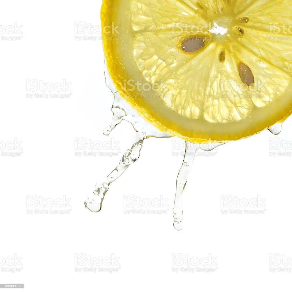 Slice of lemon in water splash royalty-free stock photo