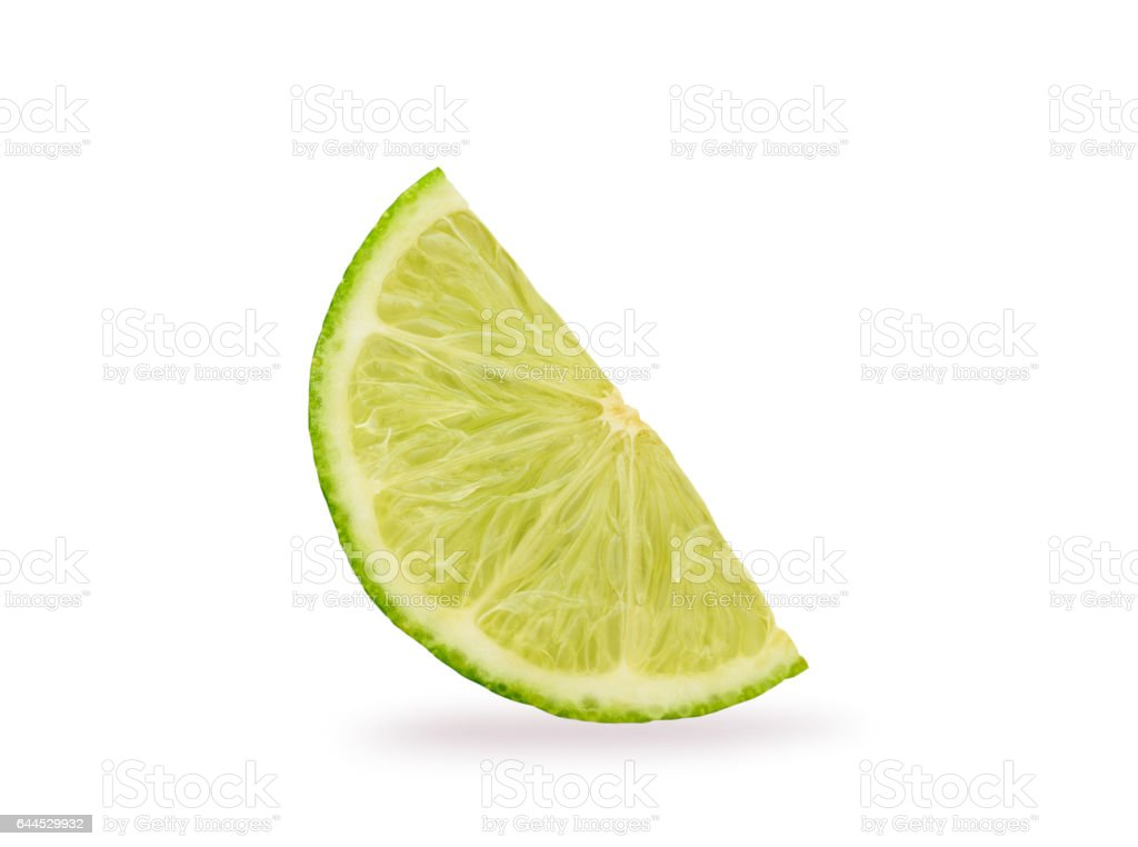 slice of lime over white background stock photo