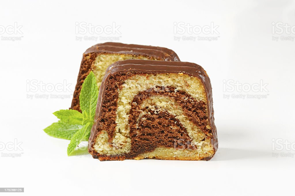 Slice of marble pound cake with chocolate glaze stock photo