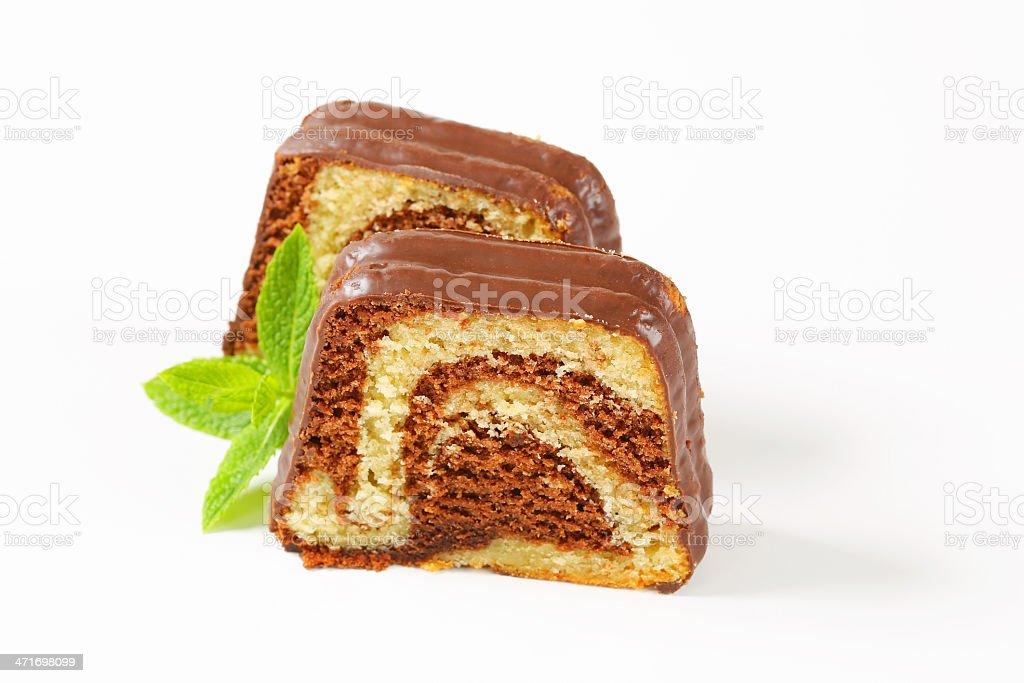 Slice of marble pound cake with chocolate glaze stock photo