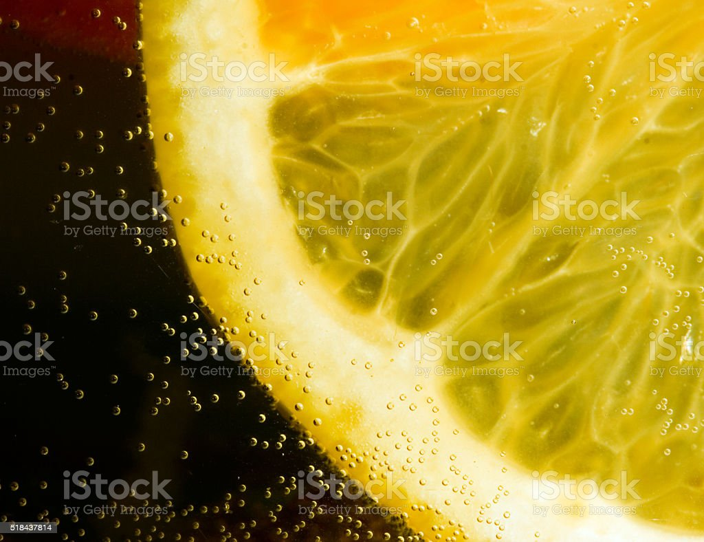 Slice of orange in bubbling water stock photo
