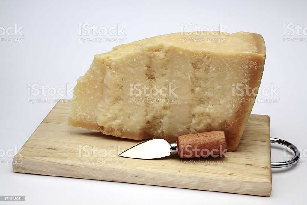 Slice of Parmesan cheese royalty-free stock photo