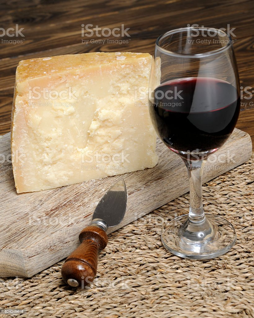 Slice of Parmesan cheese with wine stock photo
