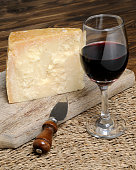 Slice of Parmesan cheese with wine