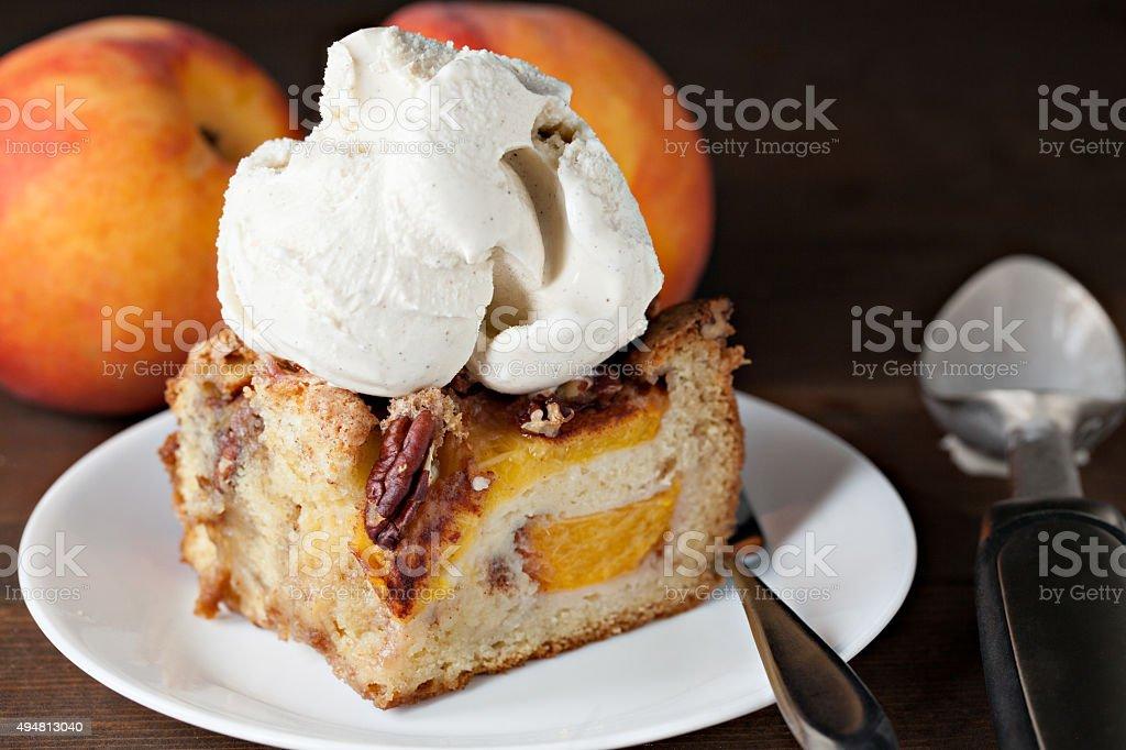 Slice Of Peach Cake  With Ice Cream stock photo