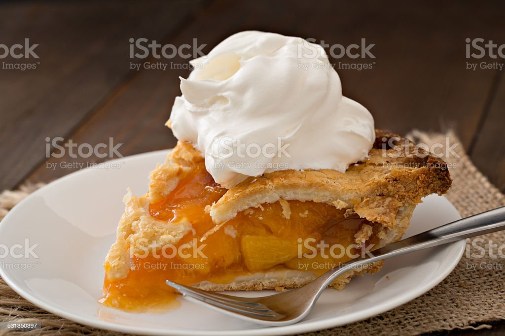 Slice Of Peach Pie And Cream stock photo