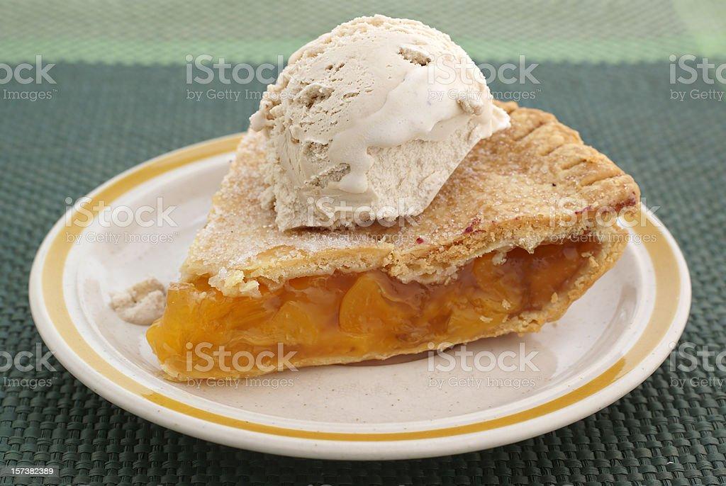 slice of peach pie with ice cream stock photo