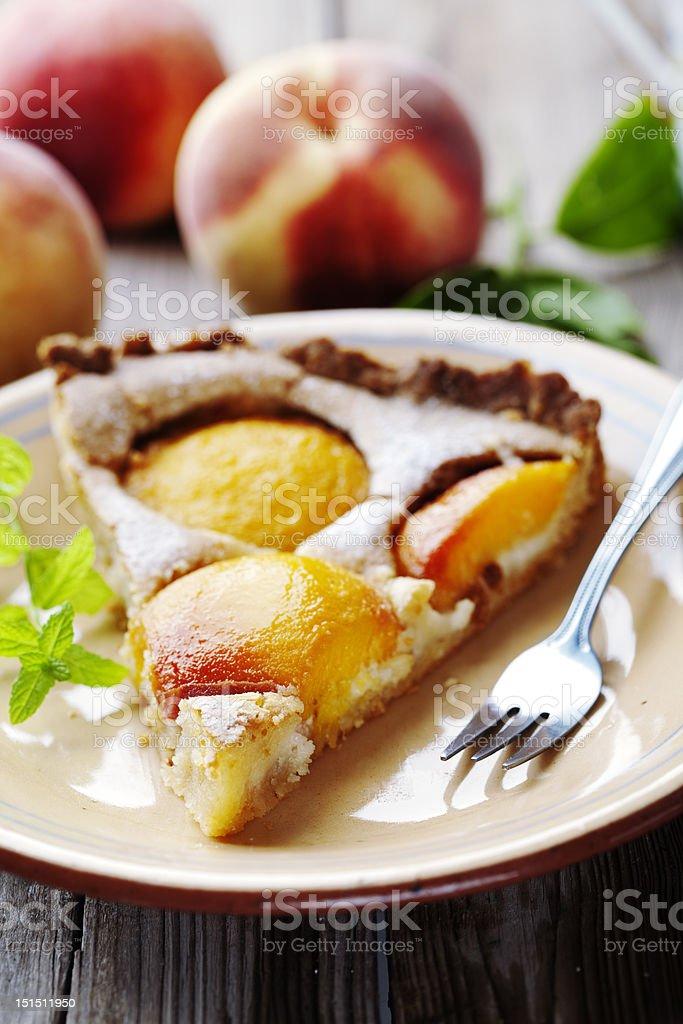 slice of peach tart stock photo