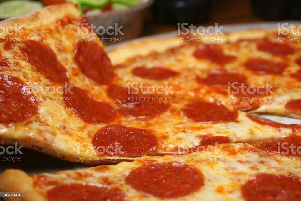 Slice of Pepperoni Pizza stock photo