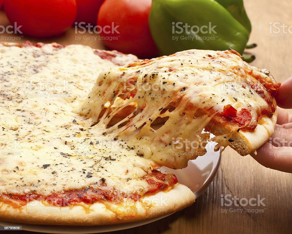 Slice of pizza margarita lifted up royalty-free stock photo
