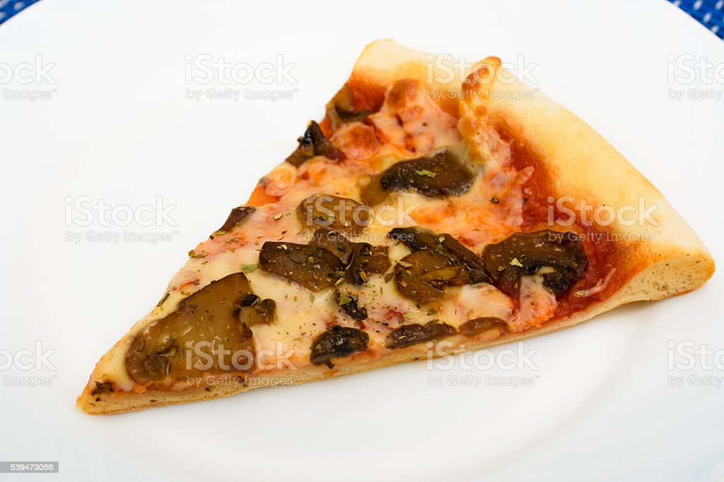 slice of pizza on a white plate stock photo