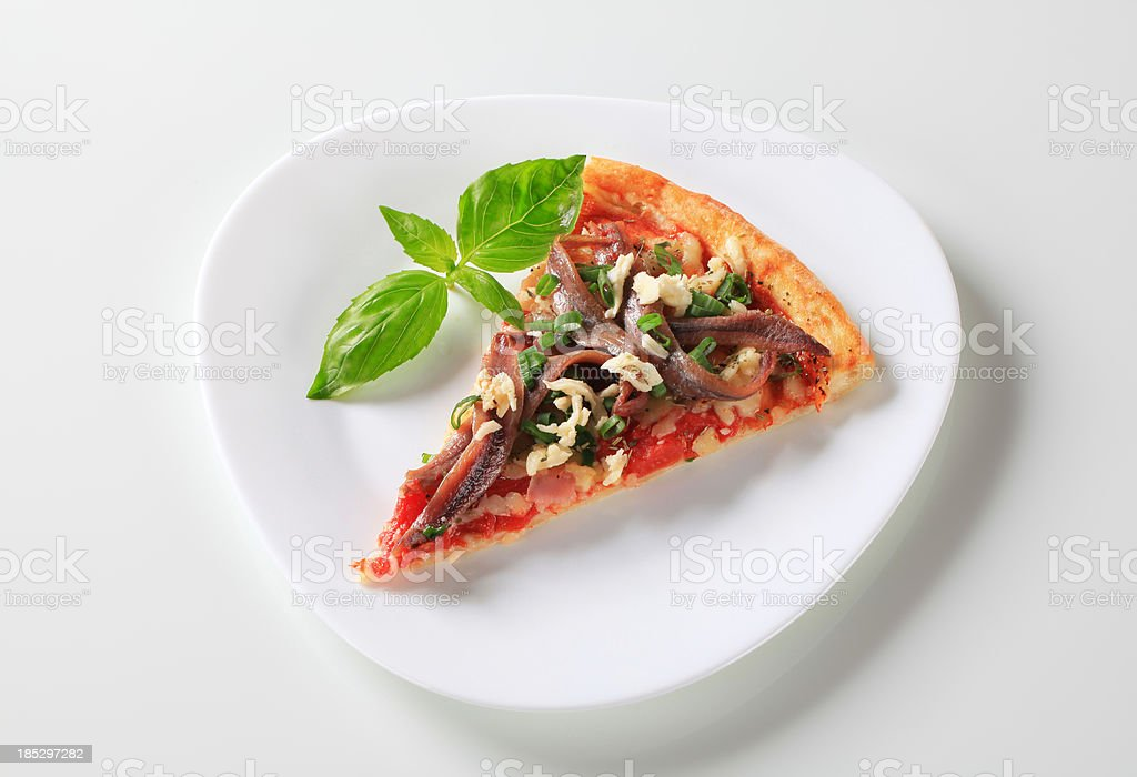 Slice of pizza with anchovy stock photo