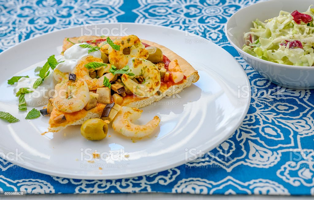 Slice of Pizza with mint tzatziki  and Shrimps. stock photo
