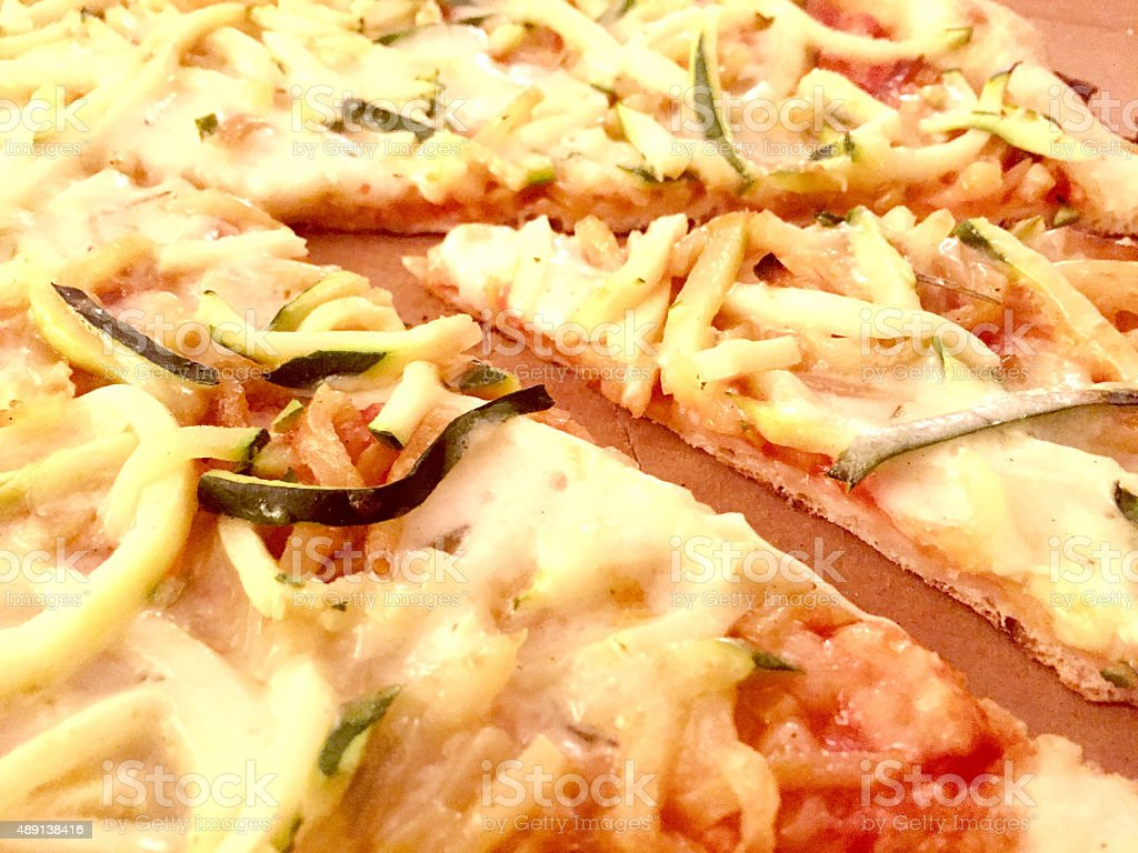 Slice of pizza with potatoes and zucchini stock photo