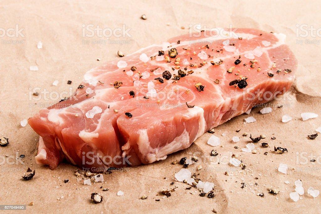 slice of pork shoulder with coarse salt stock photo