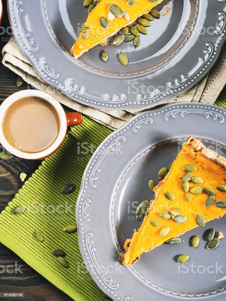 Slice of pumpkin pie and coffee stock photo