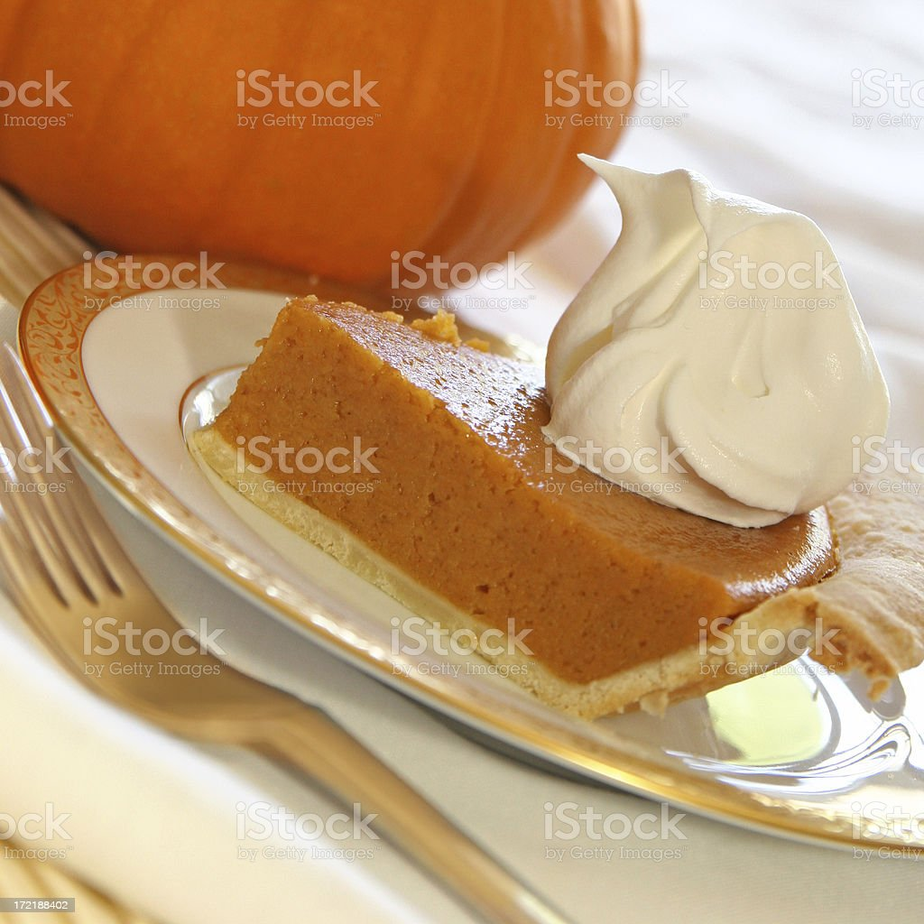 Slice of pumpkin pie royalty-free stock photo