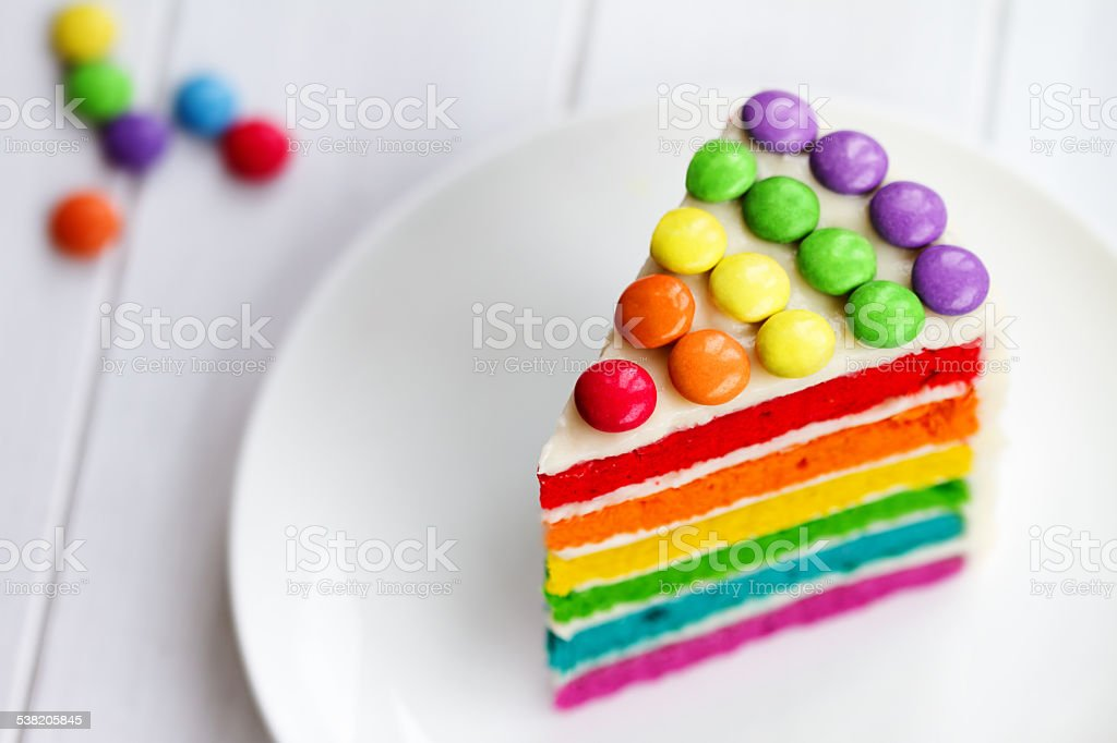 Slice of rainbow cake stock photo