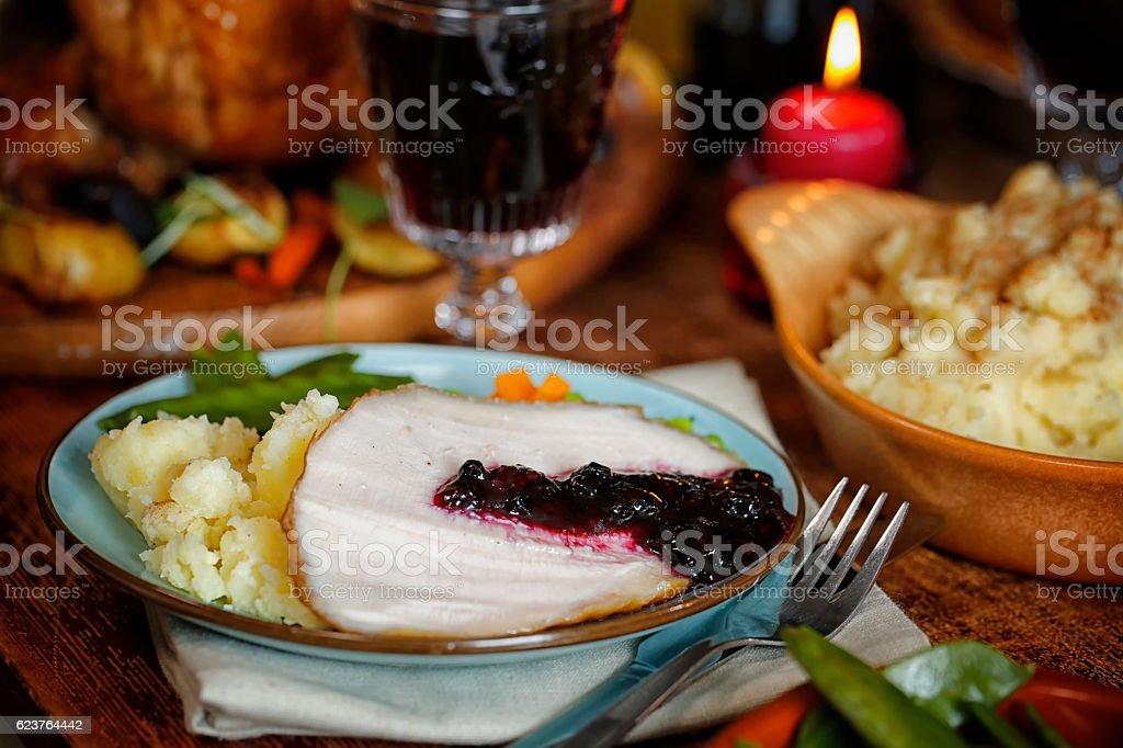 Slice of Roasted Holiday Turkey with Mashed Potatoe and Vegetables stock photo