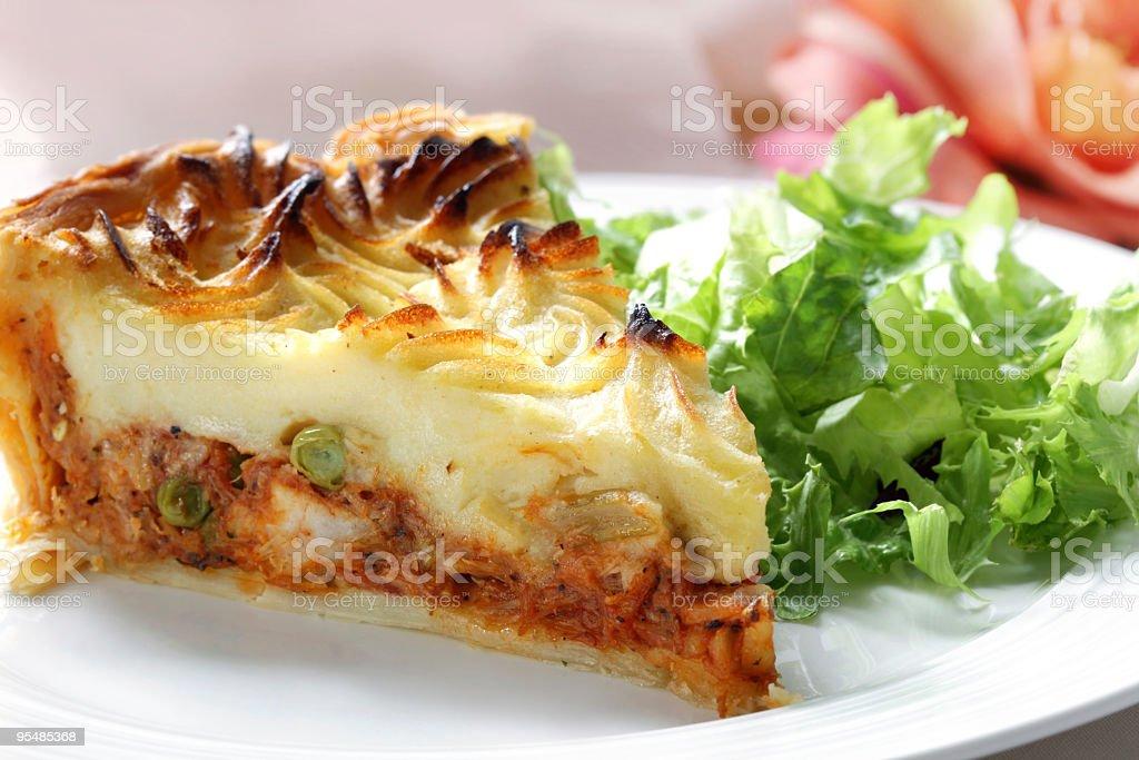 Slice of shepherds pie with side salad stock photo