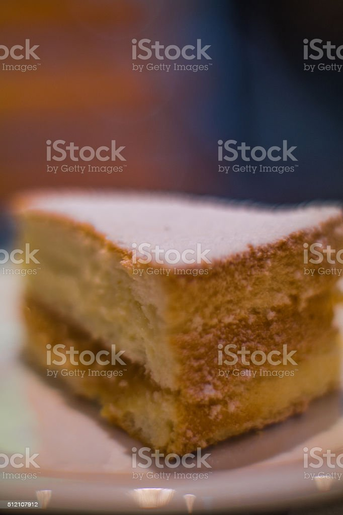 slice of sponge cake cake with blurred background stock photo