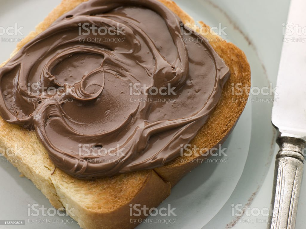 Slice of Toasted brioche with Chocolate Spread royalty-free stock photo