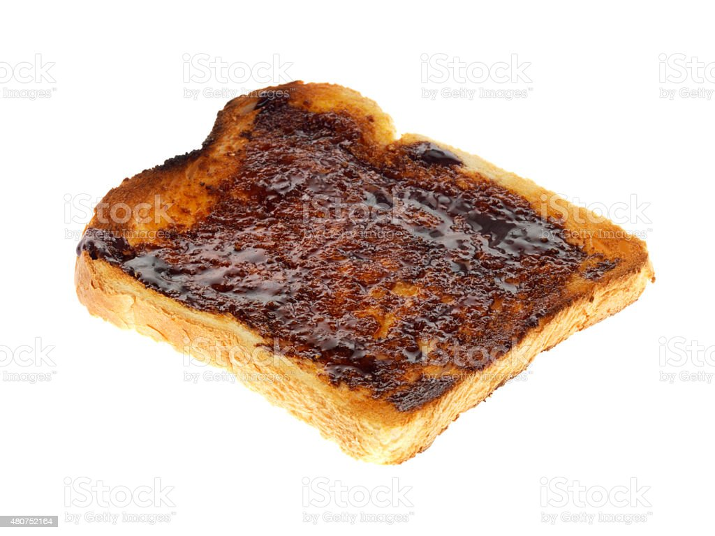 Slice of Toasted White Bread Spread with Yeast Extract stock photo