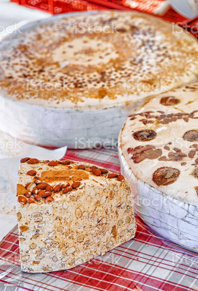 Slice of torrone dessert on counter in Ascona stock photo