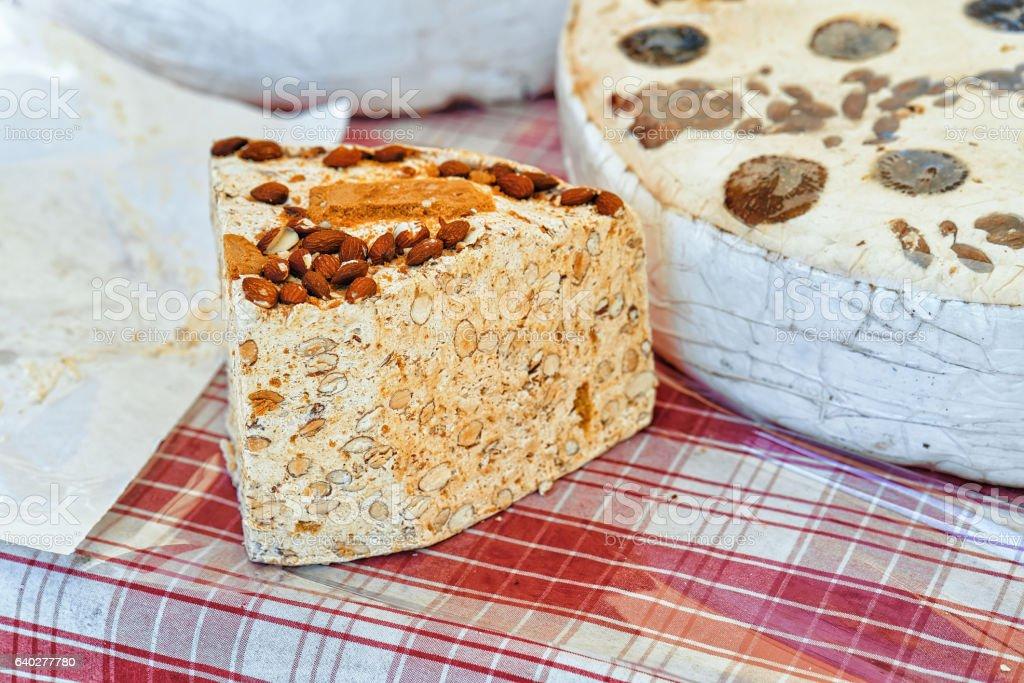 Slice of torrone nougat on counter in Ascona stock photo