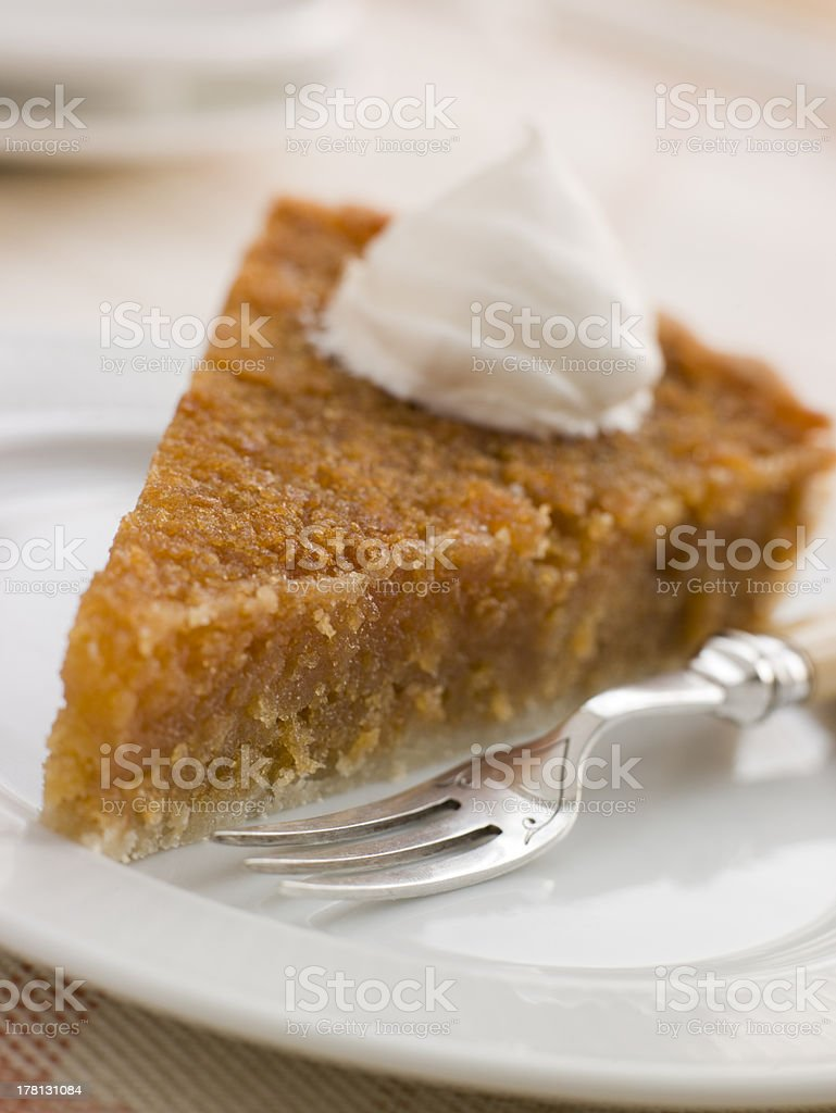 Slice of Treacle Tart with Whipped Cream stock photo
