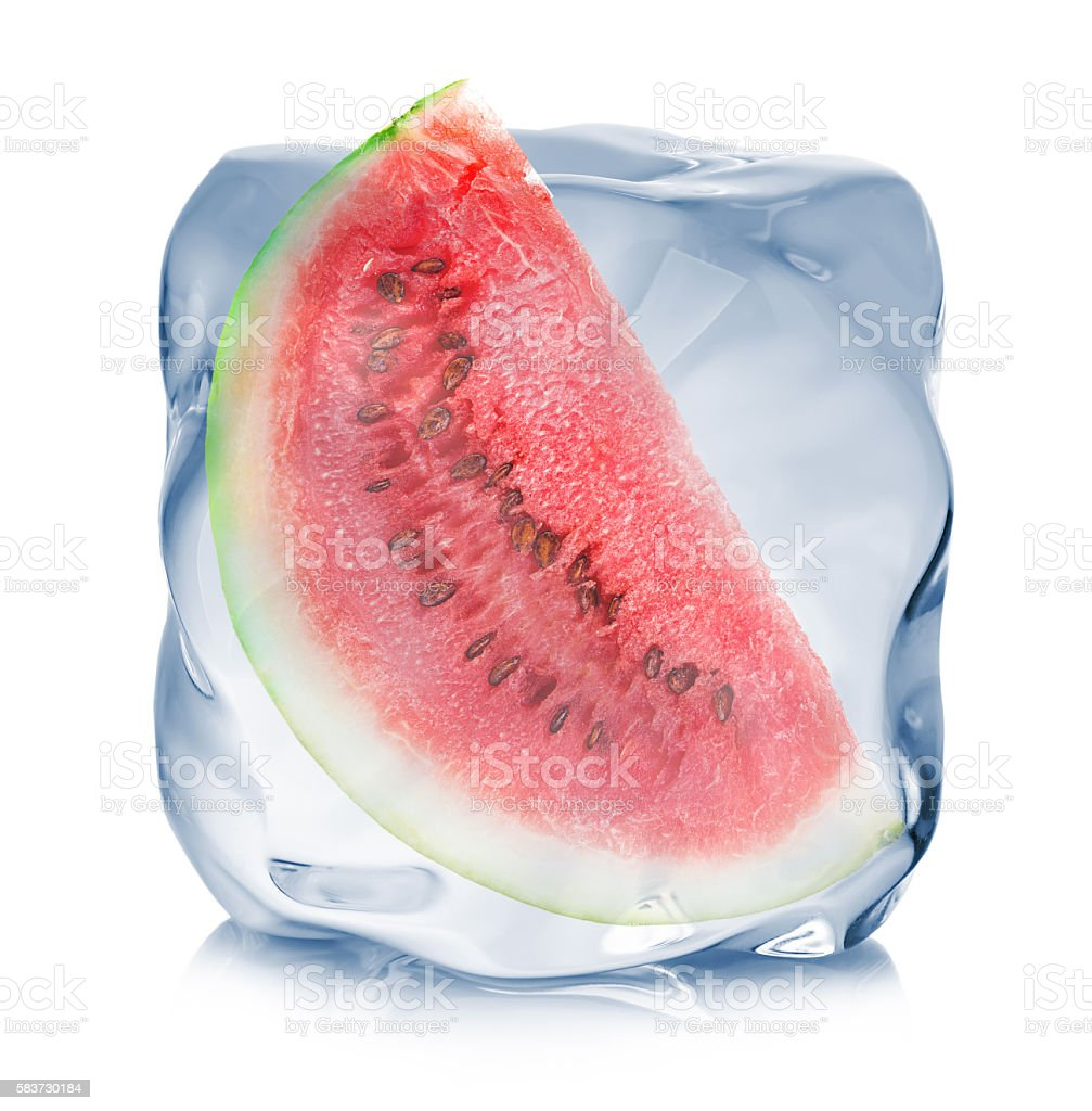 Slice of watermelon frozen in the ice cube close-up isolated. stock photo