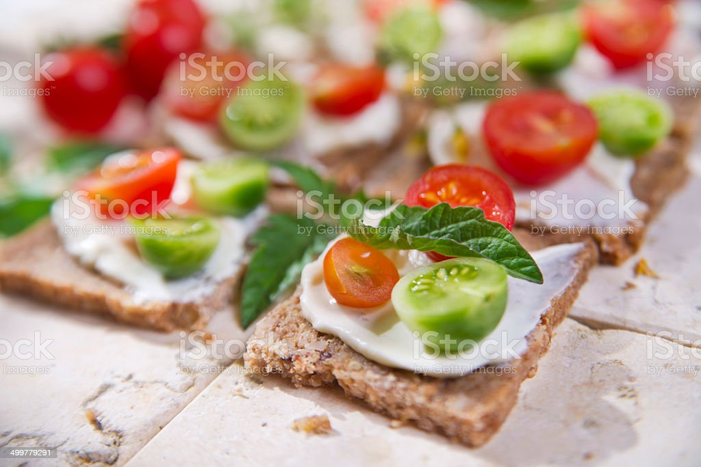 Slice of whole wheat bread and cherry tomatoes stock photo