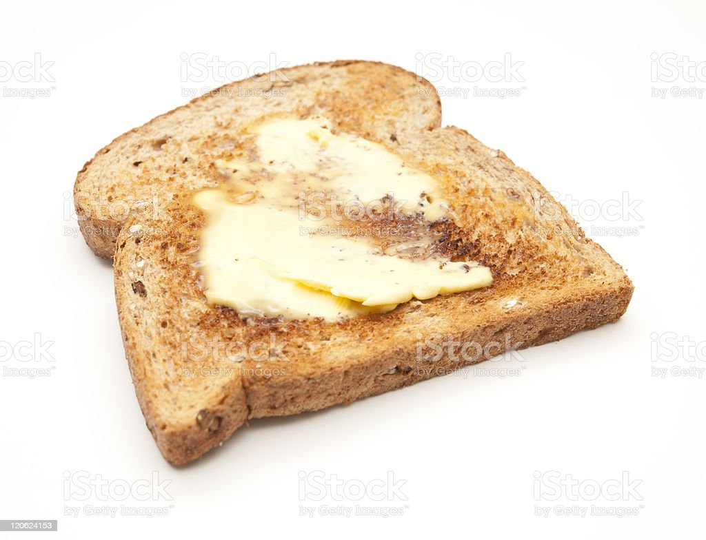 slice of wholemeal buttered toast stock photo