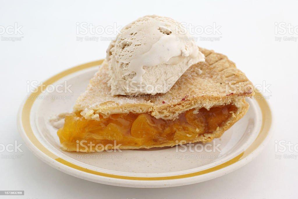 slice peach pie with ice cream stock photo
