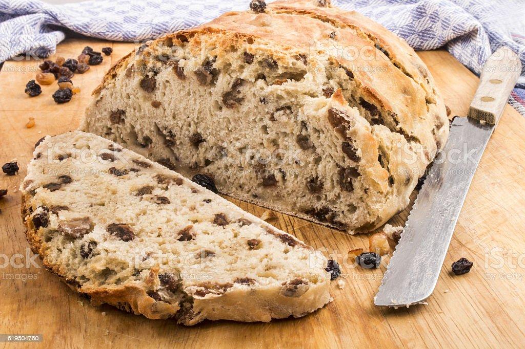 slice raisin bread with knife stock photo