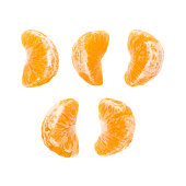Slice sections of tangerine isolated over the white background