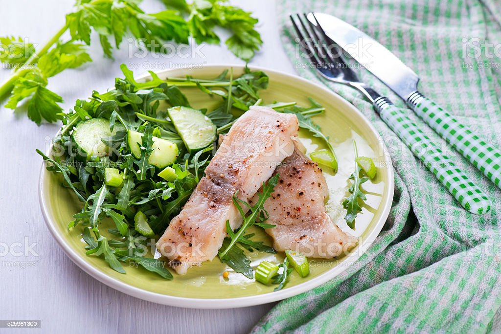 Slice steamed fish with spicy sauce and salad stock photo